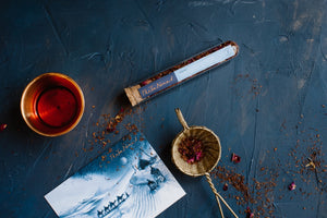 Test Tube of The Tea Nomad's Sahara tea- a caffeine- free blend of organic rooibos, crushed vanilla and red rose petals
