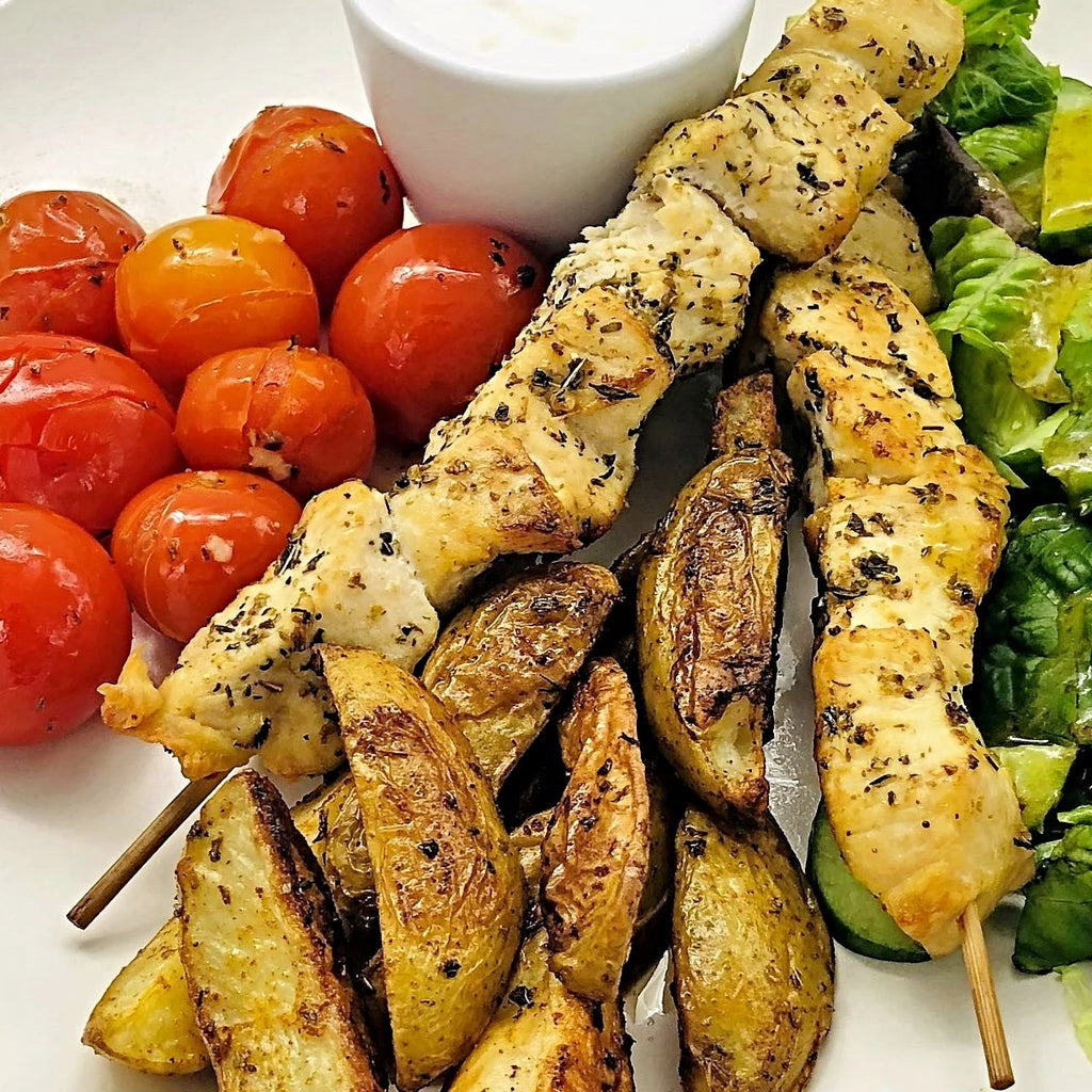 Familychef 30' Chicken Souvlaki With Baked Potatoes & Cherry Tomatoes plate
