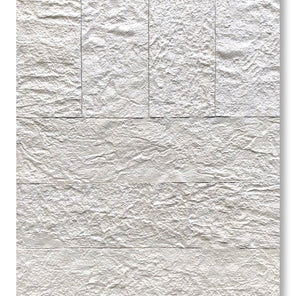 A white abstract artwork made of textured handmade paper with grooves and wrinkles creating nuances and shadows giving the appearance of depth and range.