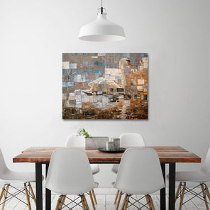 The painting, Awakening by Ned Martin hanging on a white wall above a wooden dining table and white chairs.