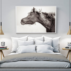 "Staged image of Curyl's ""Rockstar"". ""Rockstar"" is staged on a white wall, over a bed with light grey bedding. There are two round wooden side tables on either side of bed."