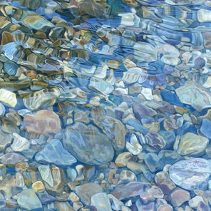 Abstracted river rocks under water, with light blues, yellow, and browns.