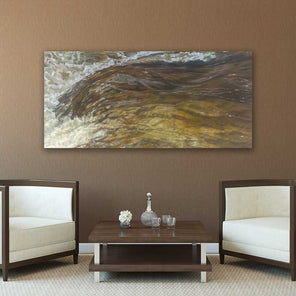 Big Branch Falls painting hanging on a brown wall above two white armchairs and a wooden coffee table.