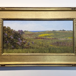 Robert Tinney's painting, Colors of Spring, in an antique gold-hued frame, hanging on a white wall.