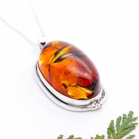 Simple Sterling Silver and natural oval Baltic amber in statement large pendant necklace