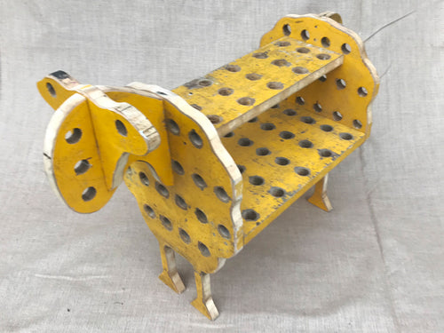 A late 1960's yellow painted wooden sheep by a French artist
