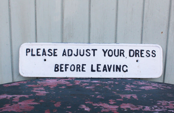 "A Cast Iron Victorian Sign ""Please Adjust Your Dress"" Before Leaving"""