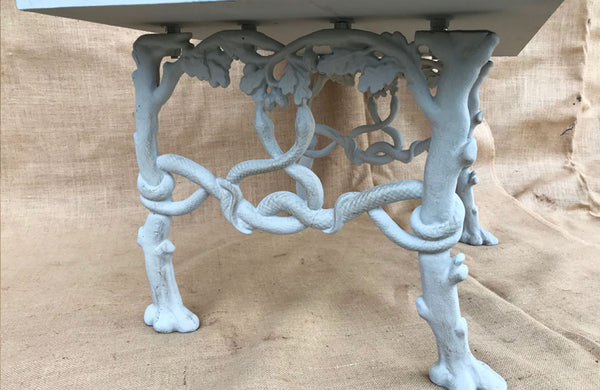 A Bench made from Antique Bench Ends Cast with Trees, Serpents & Acorns