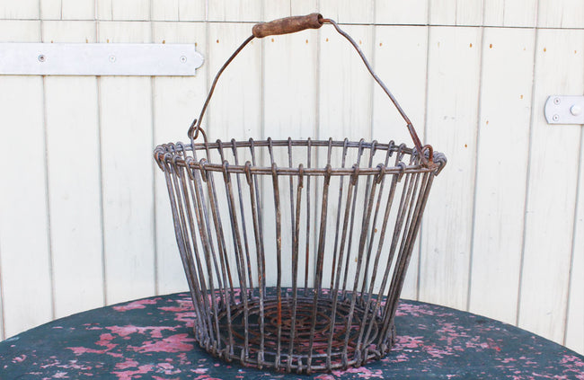A Vintage Potato Basket with Wooden Handel