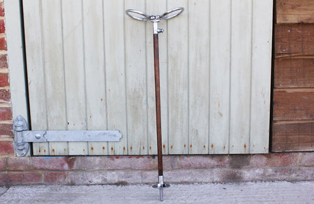 A Dronwal Iron and Brass Lawn Sprinkler