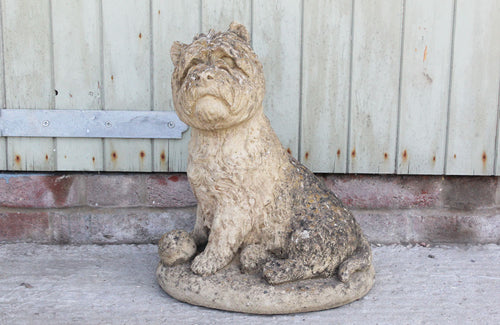 A Reconstituted Stone Figure of a West Highland Terrier Dog