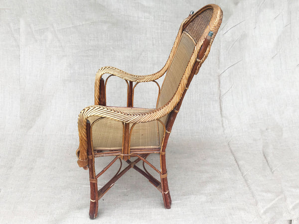 An early 20th century rattan armchair