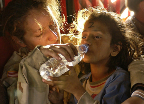 refugee girl drinking water