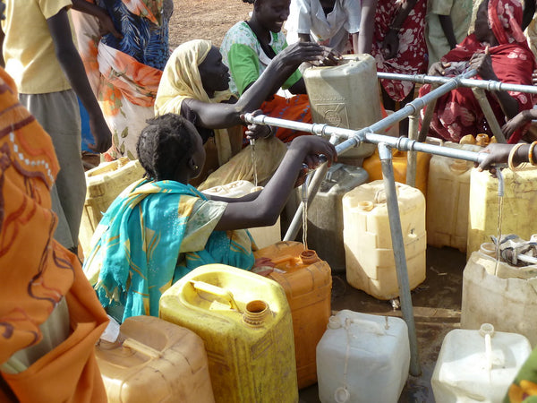 Gathering Water At Refugee Camp - Epimonia