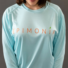Load image into Gallery viewer, aqua long sleeve islander tee on woman epimonia
