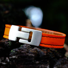 Load image into Gallery viewer, orange embracelet outside epimonia
