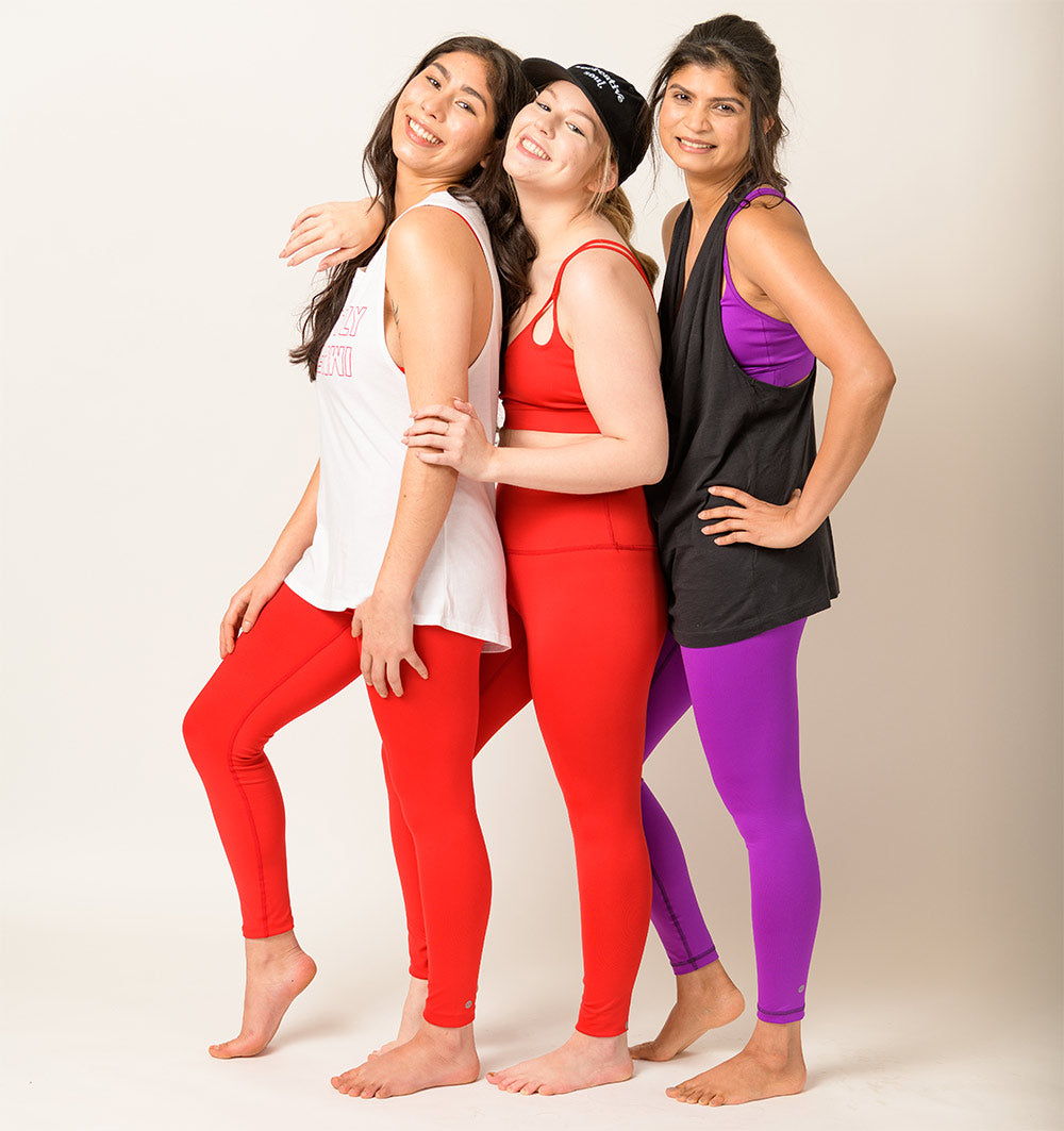 three smiley women wearing Recreative Apparel Avalon high-rise leggings and Lily light-support sports bras