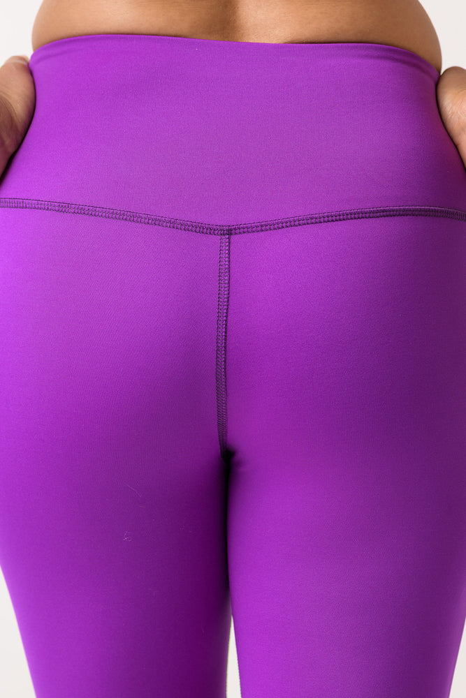 woman wearing Avalon high rise leggings in deep purple back view