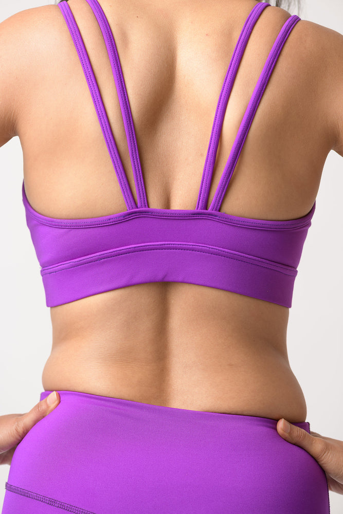 back view of woman wearing light support Lily bra in deep purple