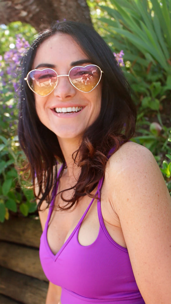 smiling woman wearing low impact purple bra