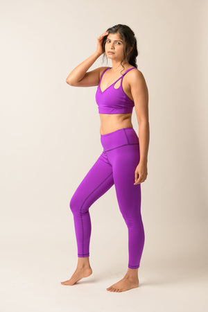 woman wearing Avalon high rise leggings in deep purple