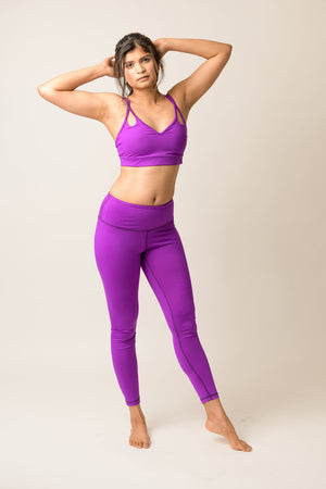 woman wearing light support Lily bra in deep purple