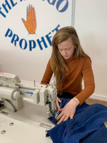 Marielle at the sewing machine.