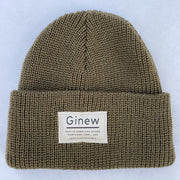 "Merino wool knit watch cap with Ginew label that says ""Native American Owned Portland, ORE - USA Mino Bimaadiziiwin"