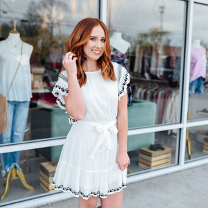 White ruffle dress with black embroidered details on the hem and sleeves - Sugar Threads Boutique