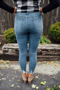 High Waisted Denim With Distressed Hem