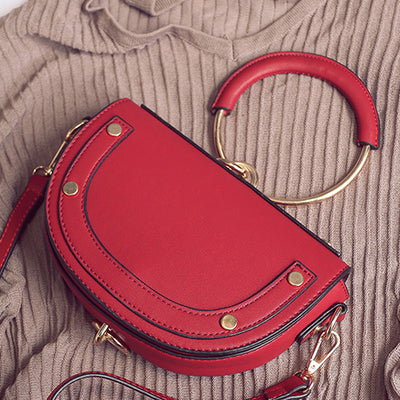 Trendy Saddle Bag with Round Handle and metal finish - Red