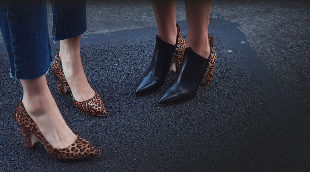 Two women with leopard sarnico pump and leopard and black Luna boots standing on pavement