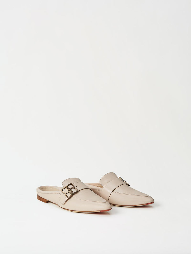 A Pair of Mavette Catania Mule Ivory Side-front View