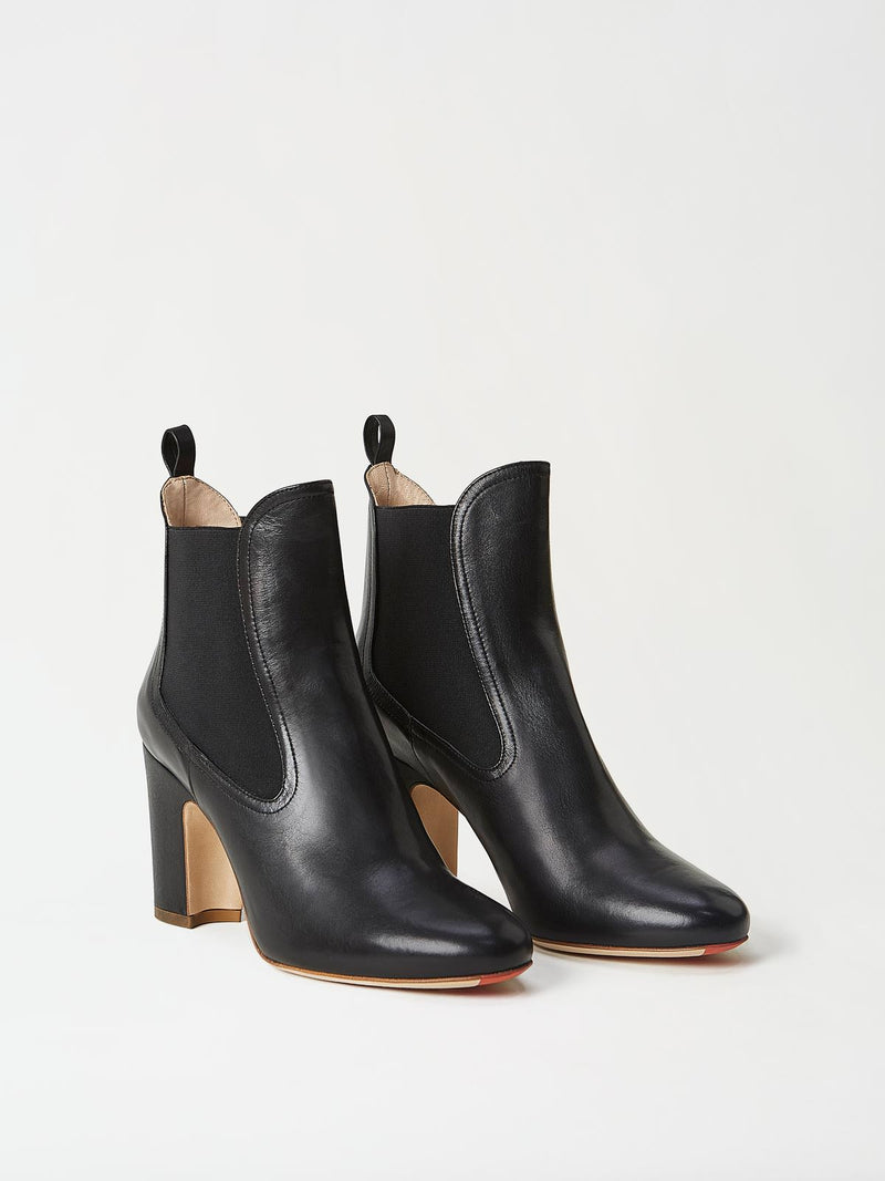 A Pair of Mavette Chelsea Boots Black Side-front View