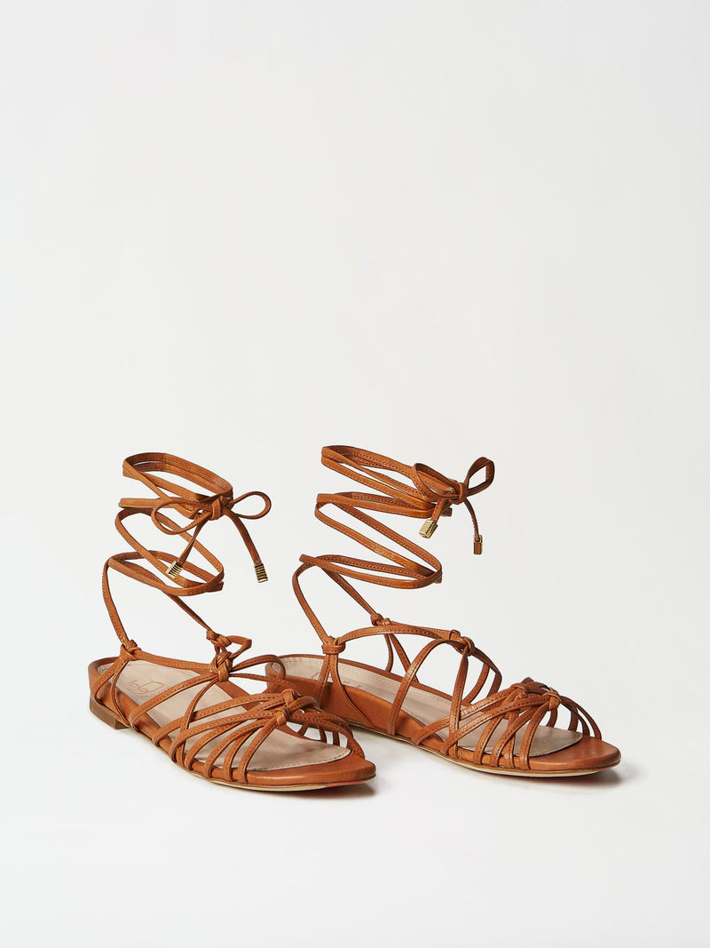 A Pair of Mavette Greca Leg Wrap Sandals - Side-Front View