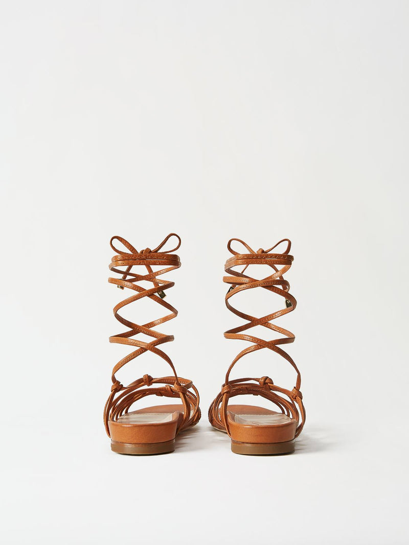 A Pair of Mavette Greca Leg Wrap Sandals - Back View