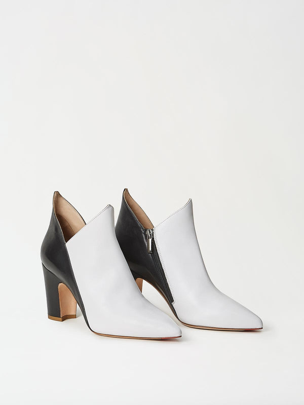 A Pair of Mavette Luna Boots White Black Side-Front View