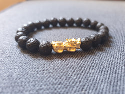 Lava stone with gold plated silver piyao 8mm