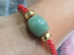 Red string with jade and 10k gold spacer