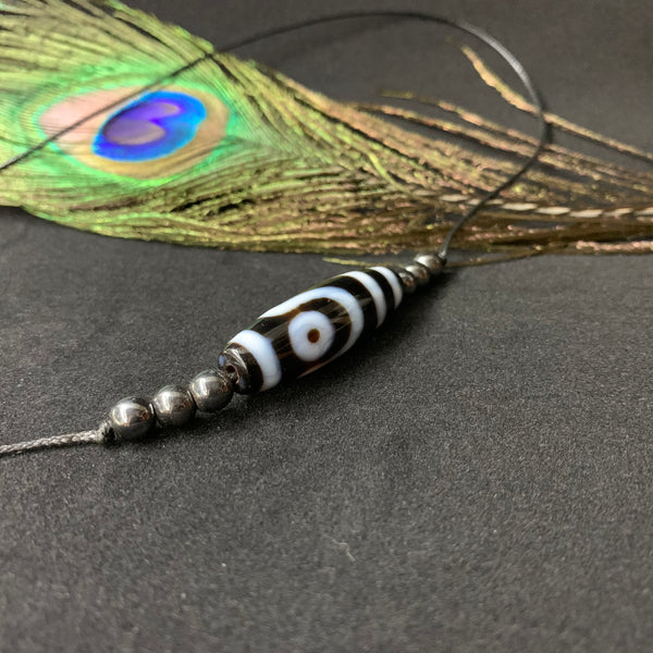 Two-eye dZi with Hematite Pendant