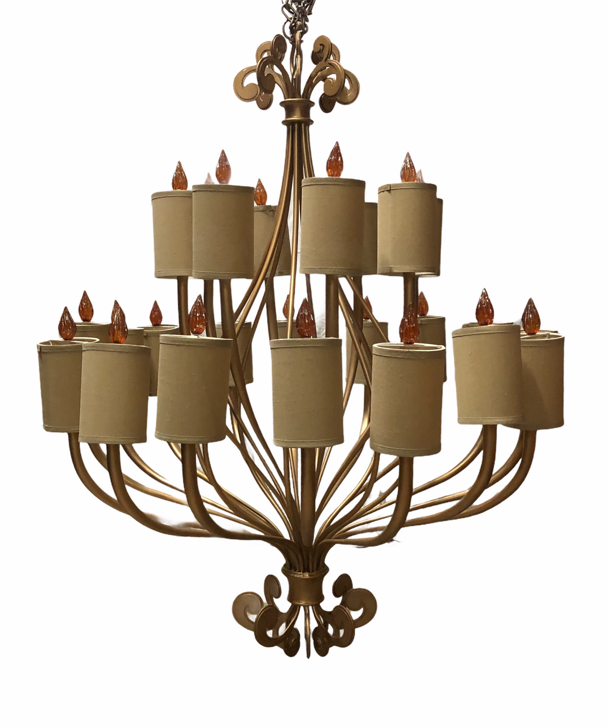 Modern gold chandelier with shades and flame finials