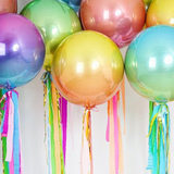 Orb Party Balloons in a range of colors filled with helium, floating together with strings attached