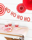 Believe red and white table runner on table with festive holiday drinks and Ho Ho Ho banner