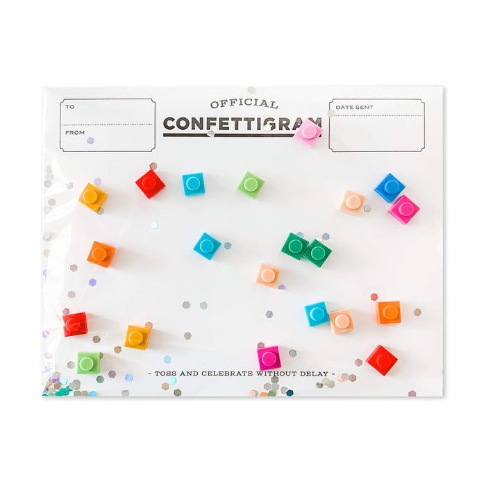 A confettigram birthday card with small Lego bricks as the confetti