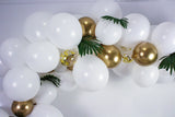 DIY Balloon Garland in white and gold including an assortment of balloons in white, gold, and clear with gold confetti 5 feet in length when assembled.