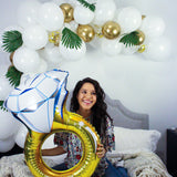 DIY Balloon Garland in White & Gold including balloons colored white, gold, and clear with gold confetti