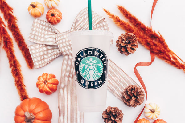 A frosted white reusable plastic Venti Starbucks cup with the Starbucks logo that reads Halloween Queen