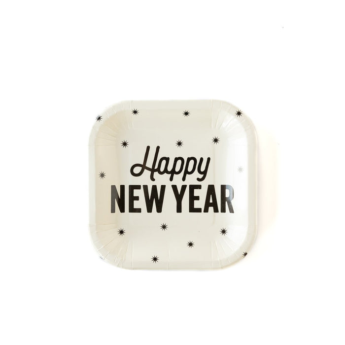 White paper plates with black text that says 'Happy New Year' and is surrounded by small stars