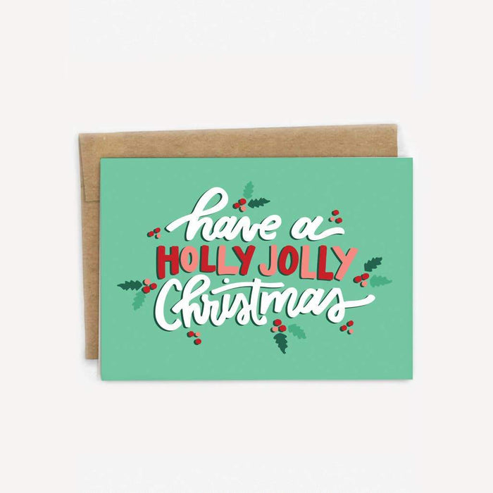 Have a holly jolly Christmas greeting card - this green greeting card with images of mistletoe and the words 'have a holly jolly Christmas' is accompanied by a Kraft paper envelope