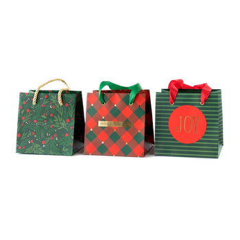 Holly mini gift bags in three different holiday designs sure to bring Christmas cheer to all those who receive them.